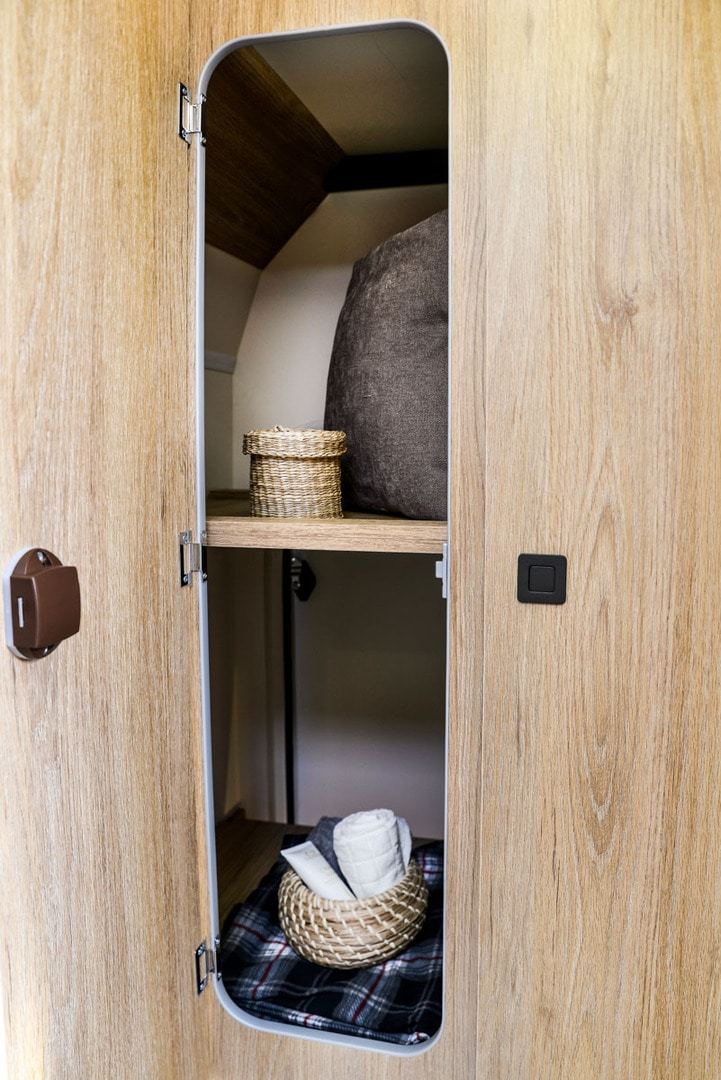cupboard space with two shelves in a motorhome for hire