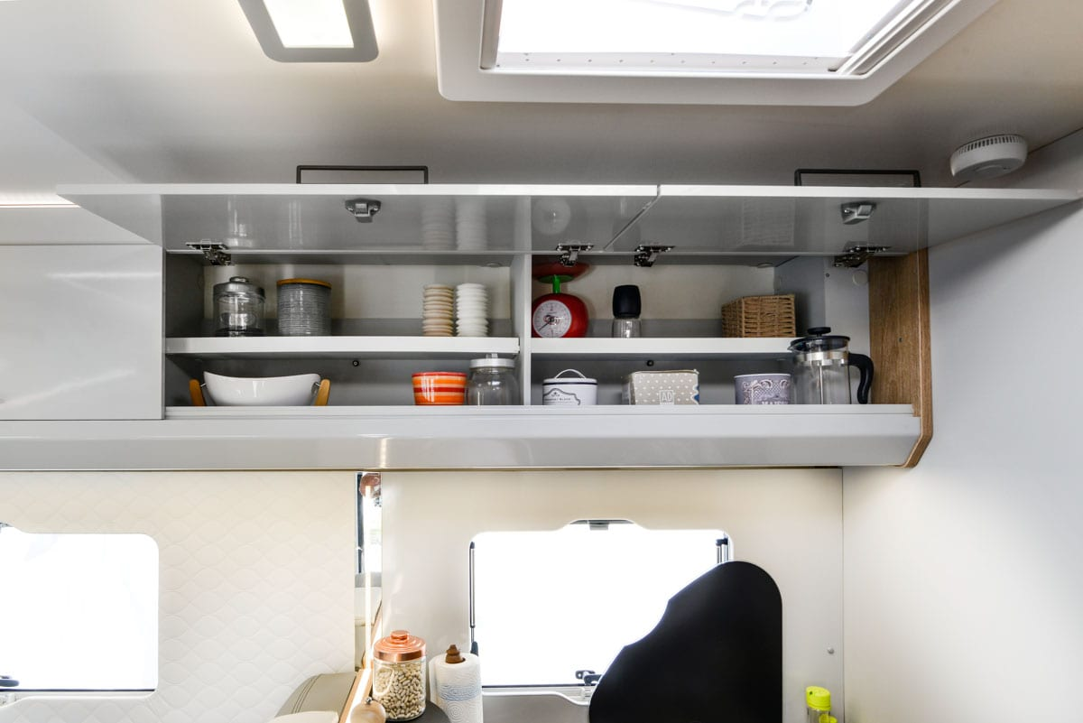 upper two cupboards in a motorhome for hire