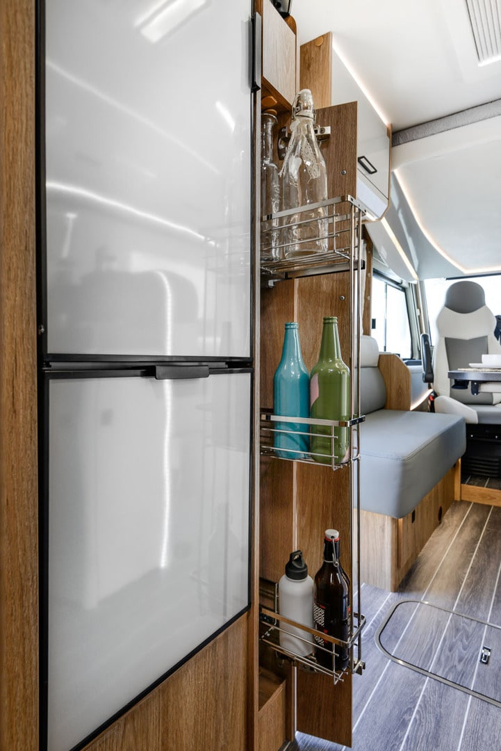 storage area in a motorhome next to the fridge